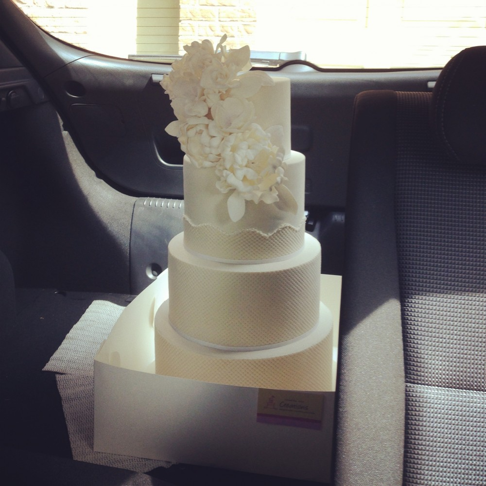 I have a hatchback so I tend to fold down one of the seats at the back so that I can check on the cake the whole time during the delivery.